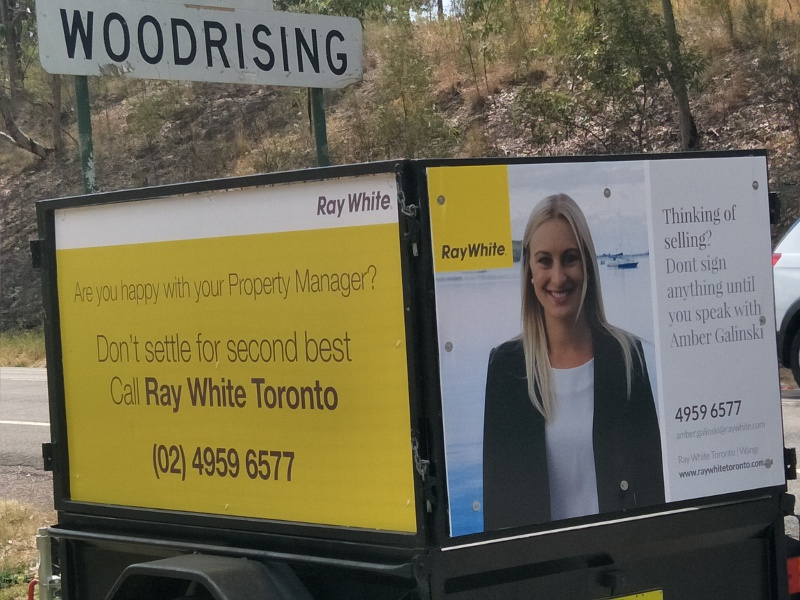 Woodrising a sign for Toronto Ray White Amber Agent