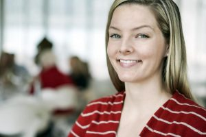 smiling woman working as a bookkeeper