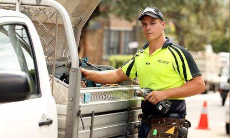 tradesperson tradesman getting tools out of ute