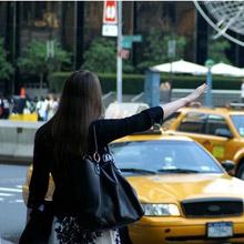 woman hailing a taxi australia